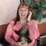 Leslie, the owner, with baby sloth