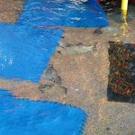 damage ground at kids pool ( holes)