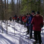 Snowshoe Club, intermediate group, on the trail at Stone Bridge