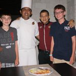 Our boys, Victor, and the chef who cooked our seafood feast