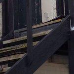 Trip hazard on top step of wooden stair case