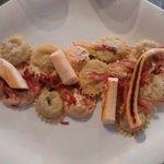 Raviolis with girolles mushrooms, grilled speck and calamari