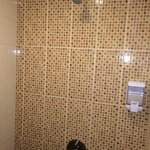 Strong pressure shower with shampoo dispenser. (Soap n toothbrust in slipper pack)