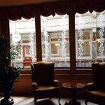 Sitting area next to the breakfast room. Plenty of windows overlooking the historic arcade.