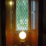 A diamond paned leaded window in the hall
