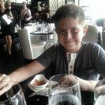 The Boy enjoying his empanada!