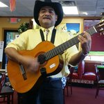 A Mexican gentleman singing to all the tables. It was very good and a nice surprise to this rest
