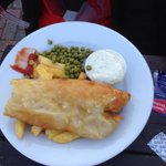 Fish and chips at the old mill- fish had already been halved and chips hiden underneath (massive