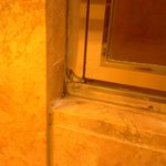 More mold and separating caulking on bottom shower door