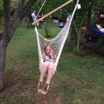 Our daughter having fun on the hammock whilst waiting on her dinner