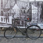 Bike in Old MArket Square infront of image from 1914.