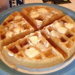 Yummy waffle with syrup and butter