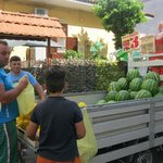 Fruit seller in front of hotel--cheap!
