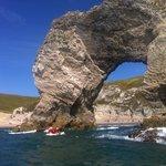 Kayaking through Durdle Door