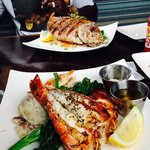 deep fried red snapper over rice and broccolini, lobster,salmon,mango bbq shrimp,garlic potato a