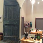 1700 year old door leading into the wine and olive oil tasting room