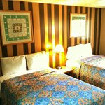 Room # 16: Two Queen size beds with TV, Fridge, Microwave, Tub/Shower and Free- WiFi