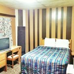Room # 22: One Queen Size bed with TV, Fridge, Microwave, Shower and Free- WiFi
