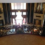 The mansion's staircase over looking the lobby entrance