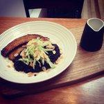 coconut black rice porridge with caramelised banana, fresh green apple, toasted almonds, honey a