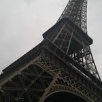 standing at foot of Eiffel Tower