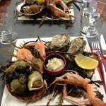 Une entrée du menu à 18€50 assiette de fruits de mer