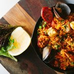 Seafood Paella - Traditional Spanish Rice Dish of Coral Fish, Prawns, Scallops, Mussels & Salmon
