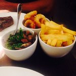 Sides of Hendersons onion rings, kale and mushrooms, chips