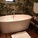 The bath tub in the Gamekeepers Suite - complete with TV