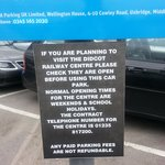Signs in Didcot Parkway Station car park advise visitors to check opening times before paying th