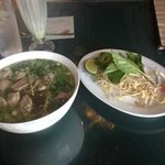 Pho and side plate of extras