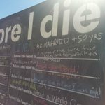 """Before I Die Board"" located on the Beach"