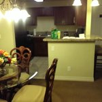 Dining/kitchen with good amount of dishes and barstools