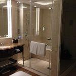 Spasious bathroom with separate bathtub and rain sower