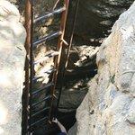 Stair way down through the rocks (ladder)