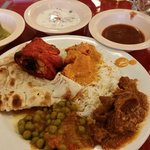 indian sauces w/tikka grilled chicken, curried goat n peas, rice naan