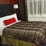 Queen size bed in suite, Club Quarters Boston  |  161 Devonshire Street, Boston, MA 02110