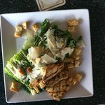 chicken caesar salad with just the right balance of cheese and dressing