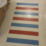 Their idea of a mat in front of the bed is multicolored strips of tiles!