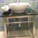Wash basin is placed on a stool like structure. No dustbin so you have to throw tissue on the fl