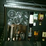 mini bar hidden in drawer,with good selection of liquors