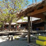 The beachfront deck, bar and main bure