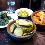 Padron peppers, olives, courgette and patatas bravas