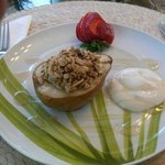Breakfast first course - baked pear with homemade granola