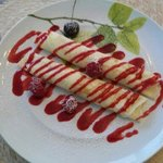 Breakfast second course - crepes with ricotta filling and raspberry sauce
