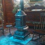 Little sitting area around an old heater stove