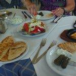 greek salad, saganaki, taziki and pita, wine leaves