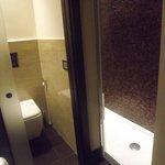 baño tipo loft habitación standar