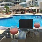 Having drinks pool side