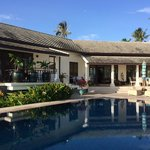 The front of the Villa by the pool and veranda